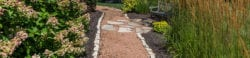 Custom backyard walking path with bench | Hittle Landscaping