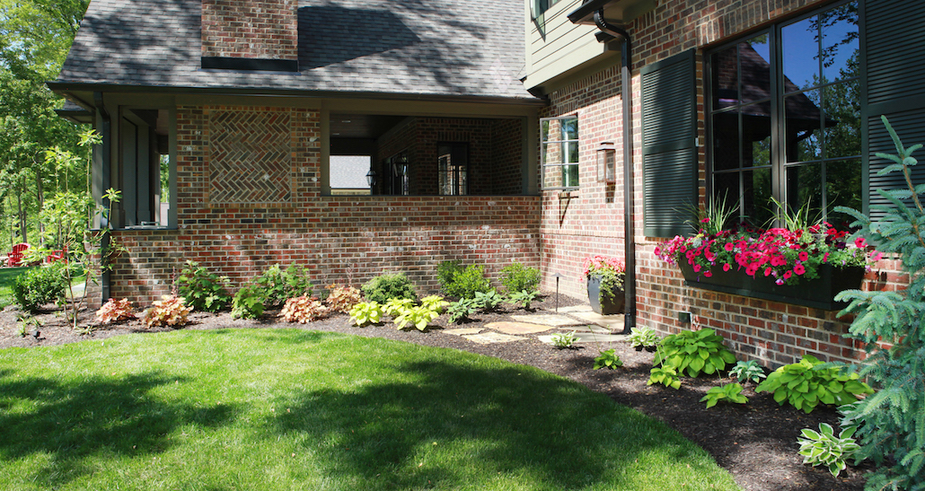 Mulched flower bed stone walkway | Hittle Landscaping