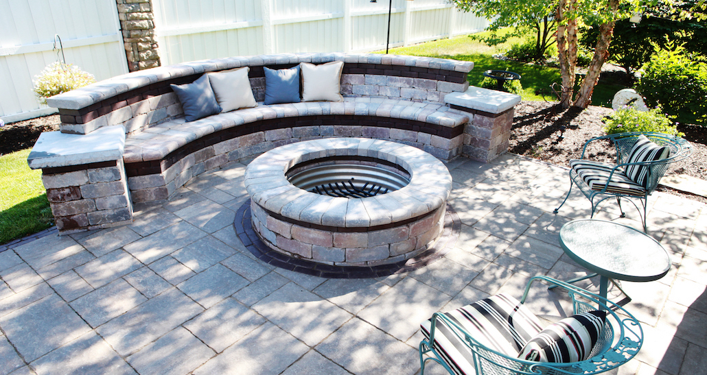Custom stone bench with fireplace | Hittle Landscaping