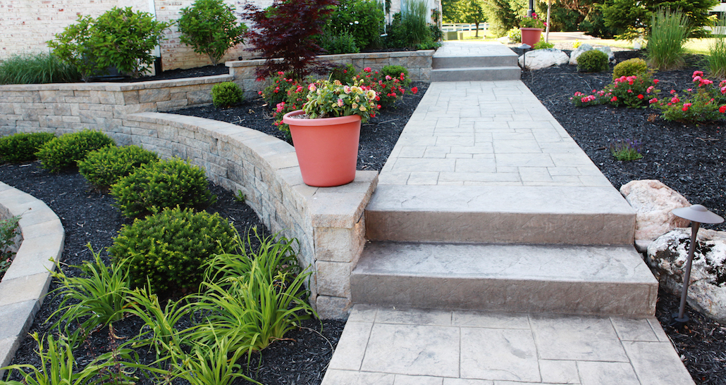 Stone sidewalk and retaining wall | Hittle Landscaping