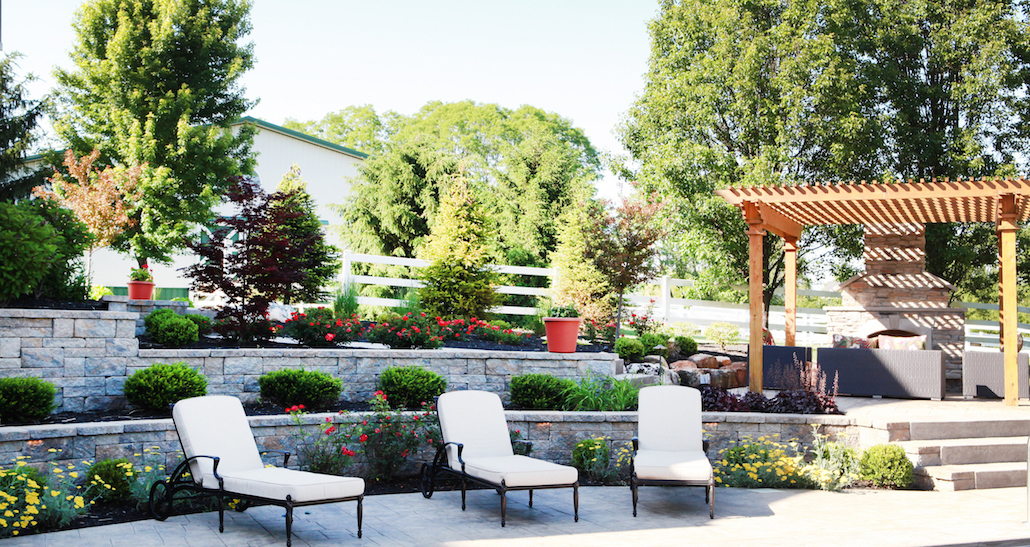 Pergola with lounge chairs on custom outdoor patio | Hittle Landscaping