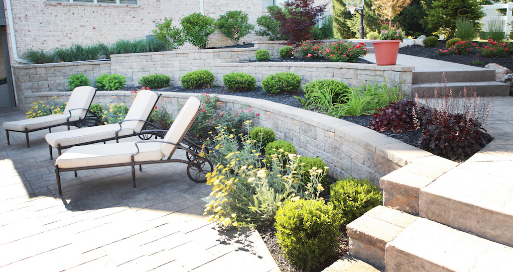 Outdoor custom lounging area with patio furniture | Hittle Landscaping