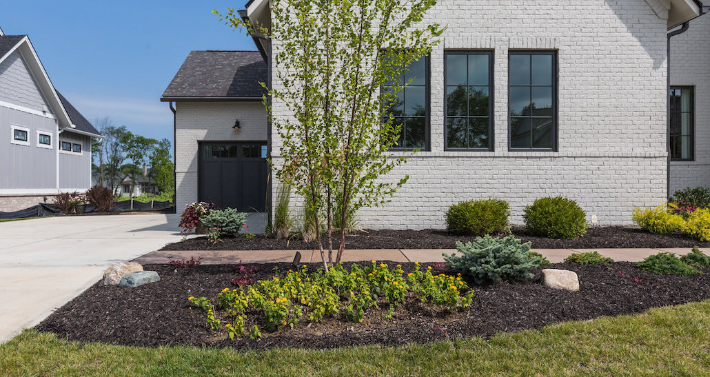Mulch and stone design with plants and trees | Hittle Landscaping
