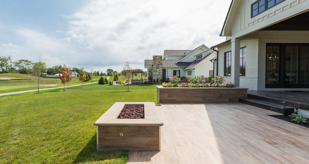 Outdoor patio with planter and gas fireplace | Hittle Landscaping