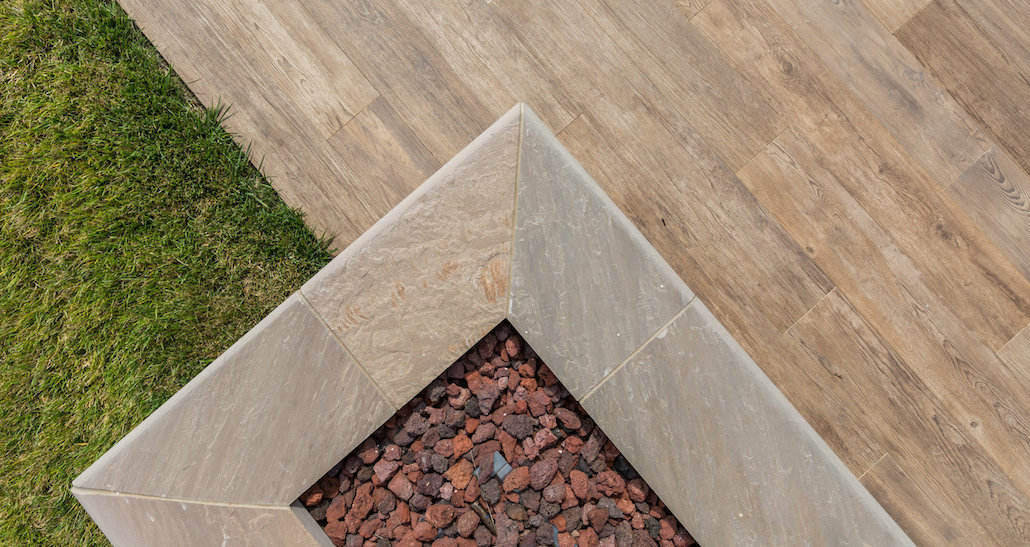 Stone outdoor design with tile patio | Hittle Landscaping