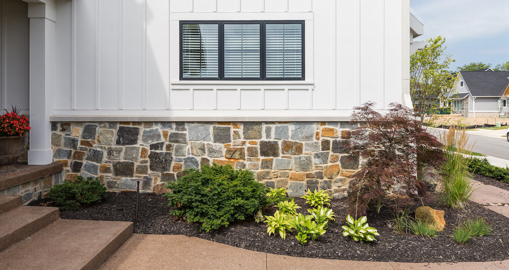 Mulched walkway and stone masonry | Hittle Landscaping