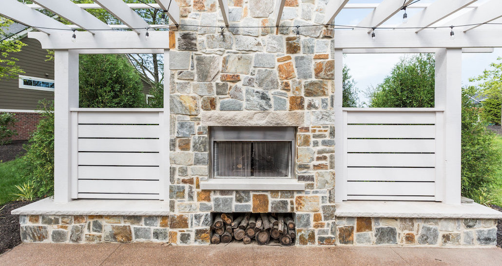 Lighted outdoor living space with fireplace | Hittle Landscaping