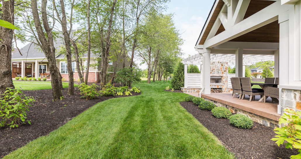 Mulched side yard with plants and patio | Hittle Landscaping