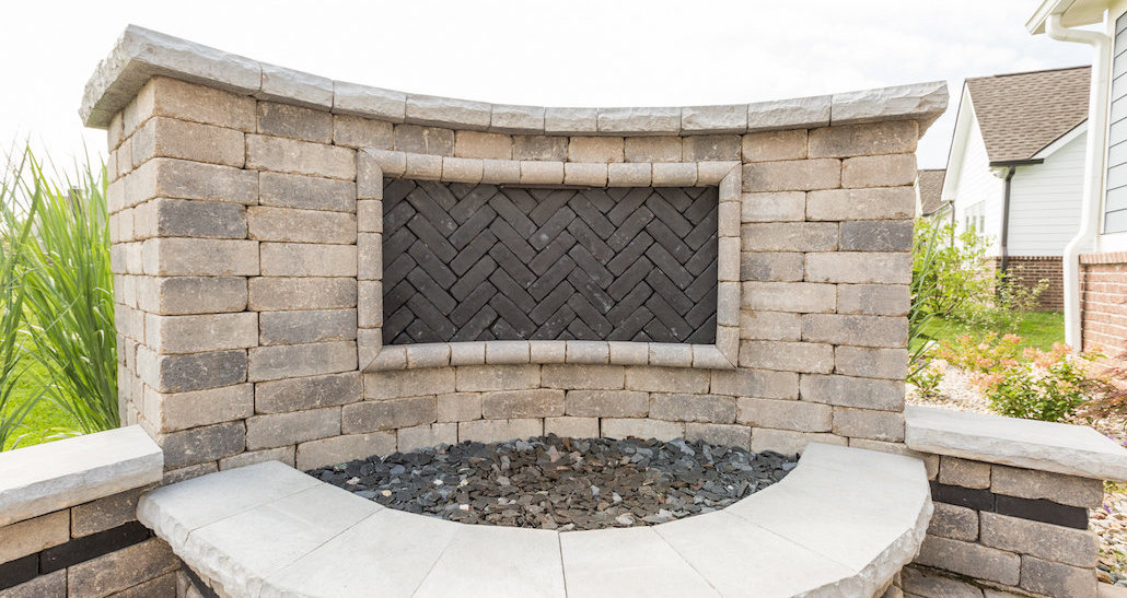 Brick and stone outdoor fireplace | Hittle Landscaping