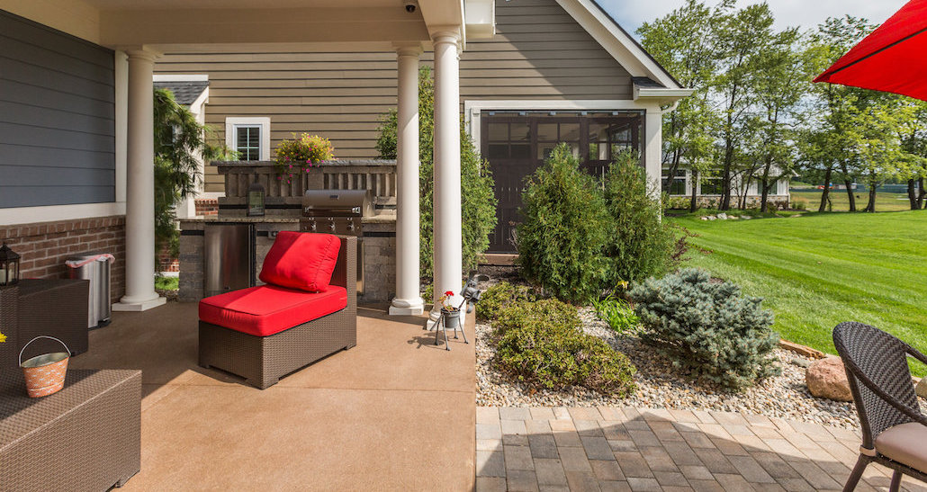 Custom brick patio with barbecue and refrigerator | Hittle Landscaping