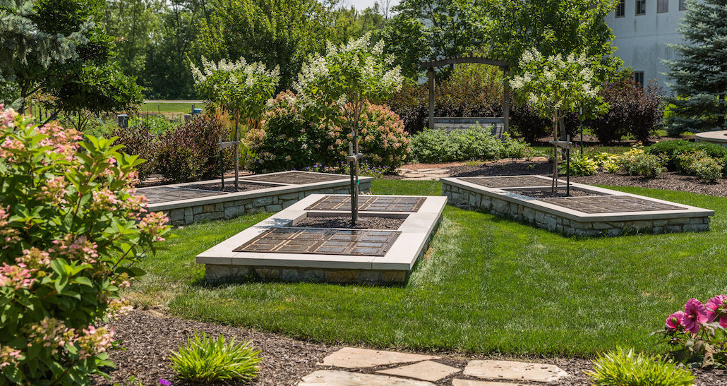 Commercial outdoor oasis with custom tree planters | Hittle Landscaping