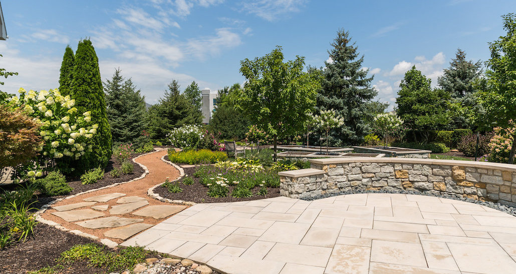 Commercial oasis with trees flowers and plants | Hittle Landscaping