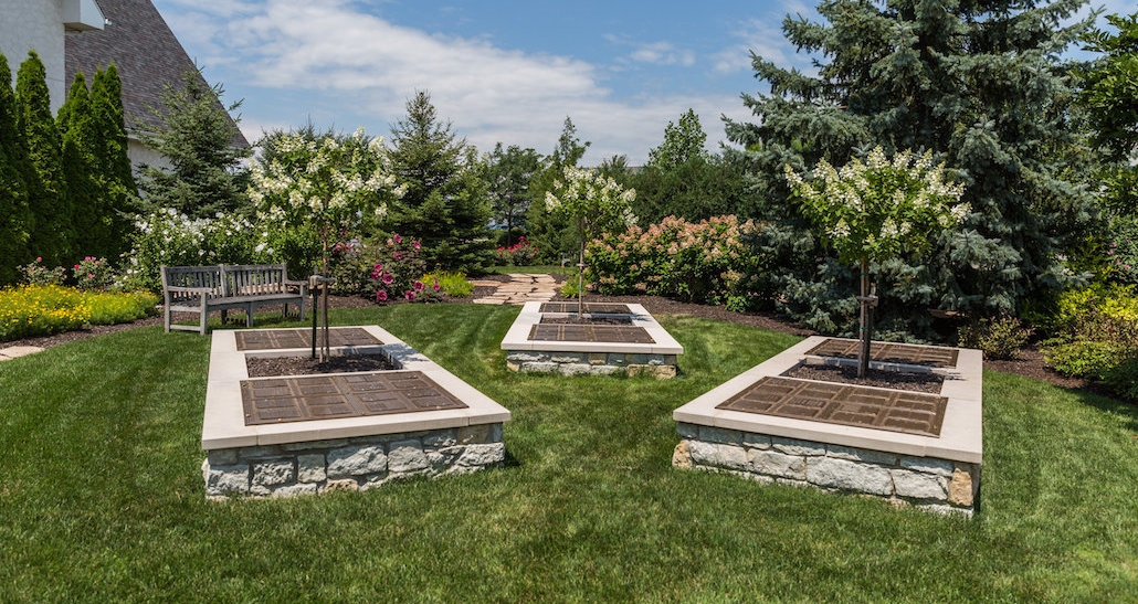 Custom designed planters with trees and bench | Hittle Landscaping