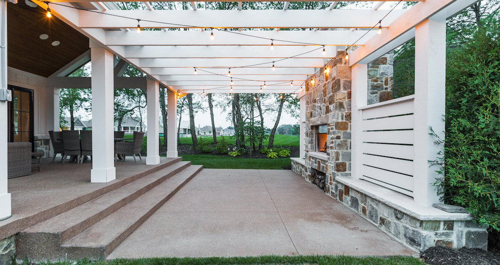 Lighted outdoor living space with trees | Hittle Landscaping