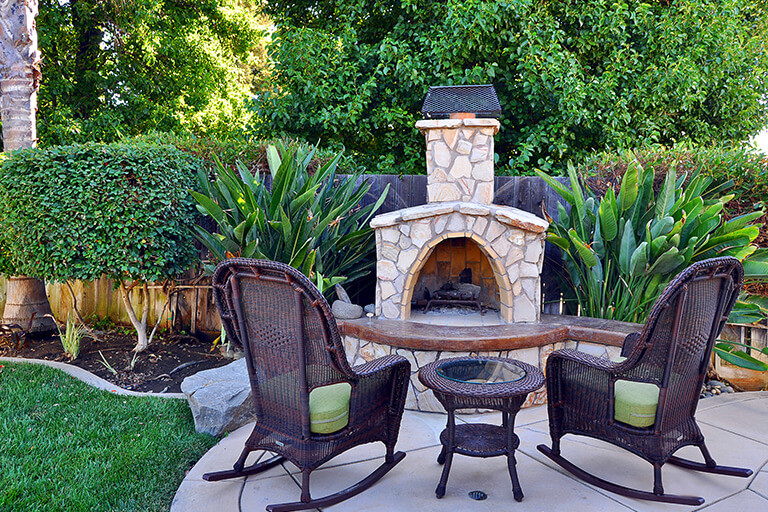 Rocking Chairs and Outdoor Fireplace | Return to Backyard Designs | Hittle Landscaping
