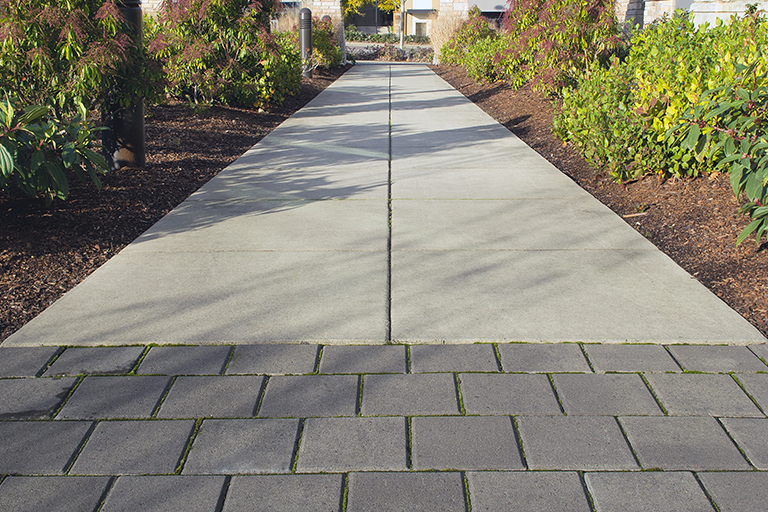 Multiple material sidewalk | Commercial Landscaping Companies Save Money | Hittle Landscaping