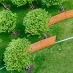 Curved bench in park setting | Basics of Quality Commercial Landscape Design | Hittle Landscaping