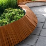 Curved wooden retaining wall | 3 Amazing Commercial Landscape Designs to Wow Customers | Hittle Landscaping
