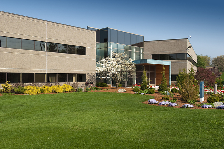 Exterior of commercial landscaped building | Top Commercial Landscaping Tips for Your Business | Hittle Landscaping