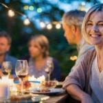 Happy woman at outdoor dinner | Redesign Your Backyard for Outdoor Entertaining | Hittle Landscaping