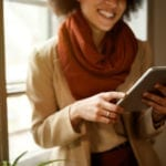 young woman red scarf holding ipad | Great Time to Plan Landscape Improvements | Hittle Landscaping