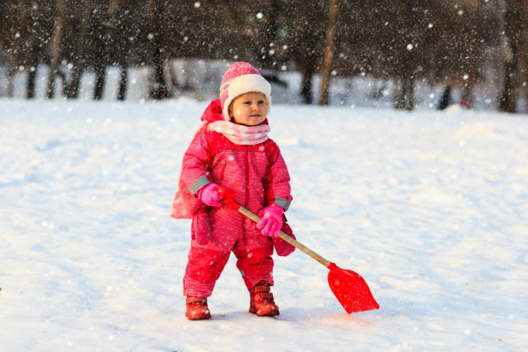 little girl with snow shovel | Protect Indianapolis Plants and Hardscapes with Snow Removal Tips | Hittle Landscaping