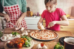 child making pizza | Plan a Backyard Garden for Cooking | Hittle Landscaping