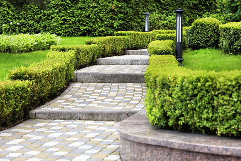 cobblestone walkway | Increase Tenants in Indianapolis with Commercial Landscape Design | Hittle Landscaping